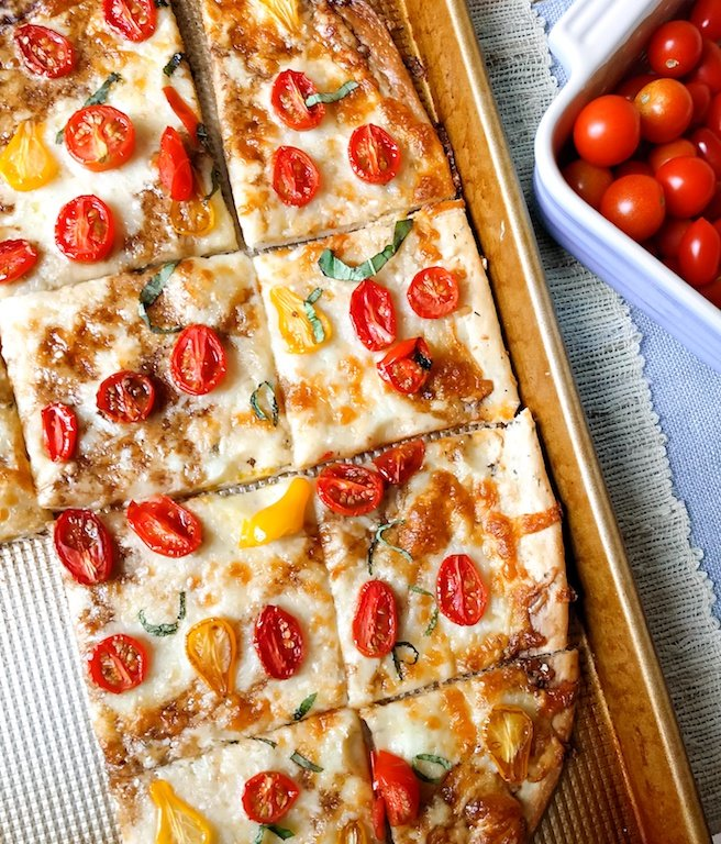 Tomato pizza with herbed crust and balsamic drizzle